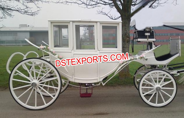 White Covered Horse Drawn Carriage